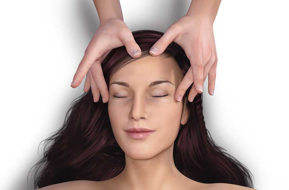 Man's hands massaging a woman's forehead